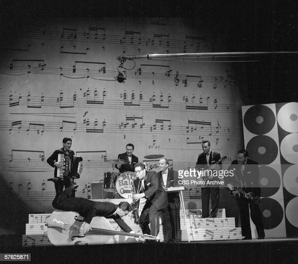 American rock and roll band Bill Haley and his Comets perform raucously on Ed Sullivan's CBS variety show 'Toast of the Town' April 28 1957 The...
