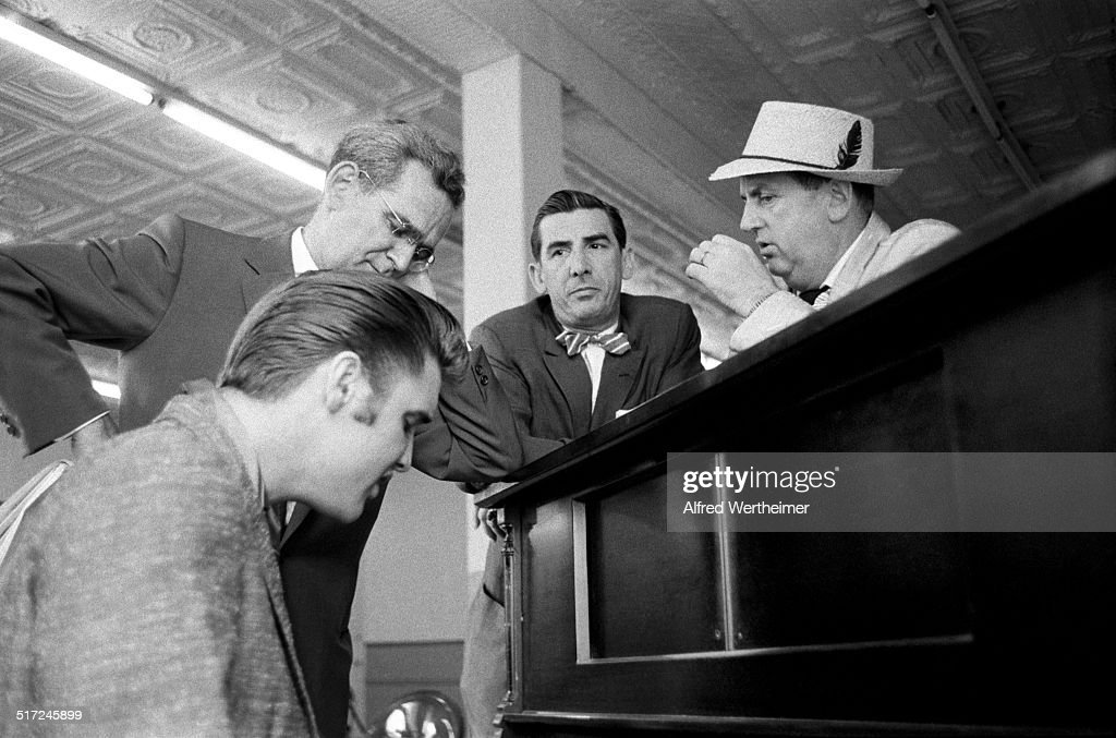 Alfred Wertheimer/Getty Images American rock and roll singer and actor Elvis Presley playing a piano as he waits to begin rehearsals for his...