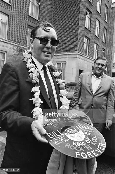 American rock and roll singer Bill Haley holds a record with a Welcome Back to Britain message shortly before his appearance at the Royal Albert Hall...