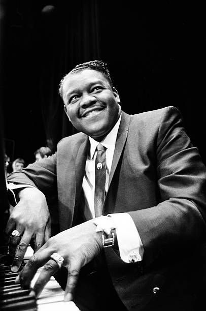 American rock and roll star Fats Domino at the piano on the stage ...