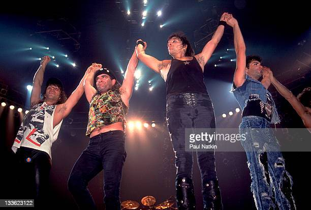 American rock band Bon Jovi waves to fans following a performance at Met Center on Bloomington Minnesota April 4 1989 Pitcured are from left Jon Bon...
