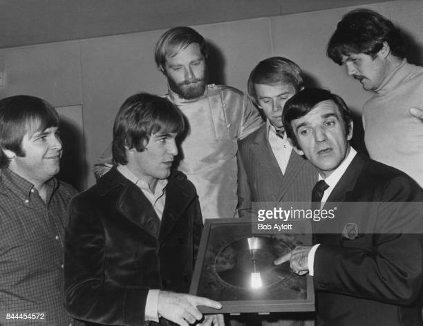 American rock band The Beach Boys receive a Silver Disc for the sales of the LP 'Best of the Beach Boys' during a reception at the Hilton Hotel in...