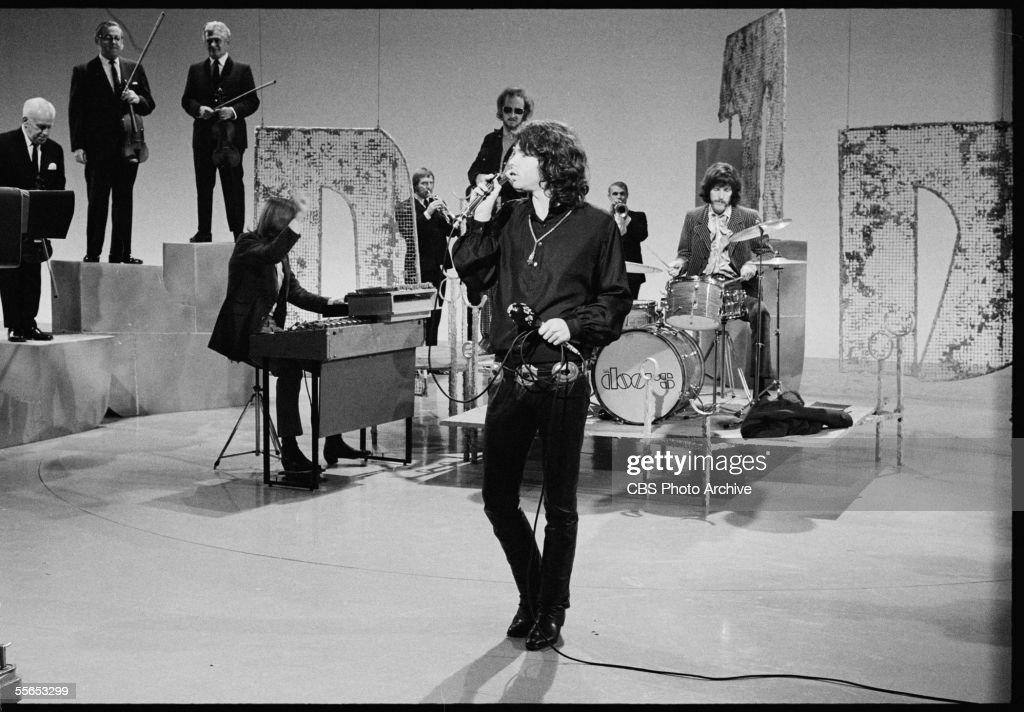 American rock band The Doors, led by singer Jim Morrison (1943 - 1971) , perform on 'The Smothers Brothers Comedy Hour' backed up by other musicians, California, January 6, 1969. Behind Morrison is the rest of the band: (L-R) organist Ray Manzarek, guitarist Robby Krieger and drummer John Densmore.