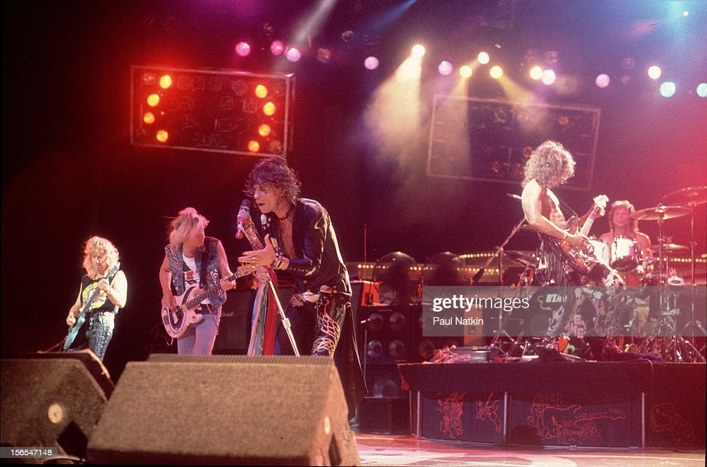 American rock group Aerosmith performs onstage Chicago Illinois July 1 1994 Pictured are from left Brad Whitford Tom Hamilton Steven Tyler Joe Perry...