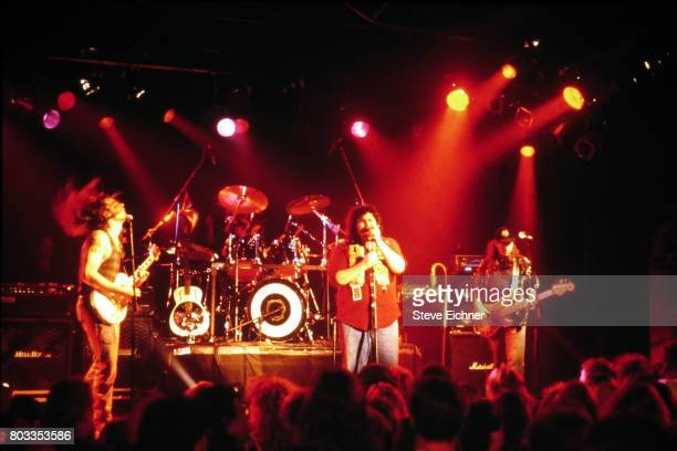 American Rock group Blues Traveler performs onstage at an unspecified venue New York New York 1995 Pitcured are from left Chan Kinchla on guitar...