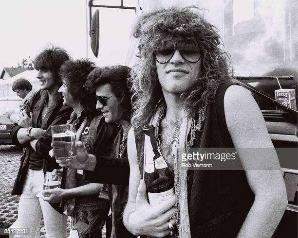 American rock group Bon Jovi backstage at the Monsters Of Rock festival in Mannheim West Germany 31st August 1986 LR Richie Sambora Alex John Such...