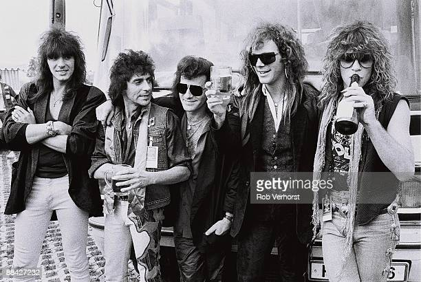 American rock group Bon Jovi backstage at the Monsters Of Rock festival in Mannheim West Germany 31st August 1986 LR Richie Sambora Alex John Such...