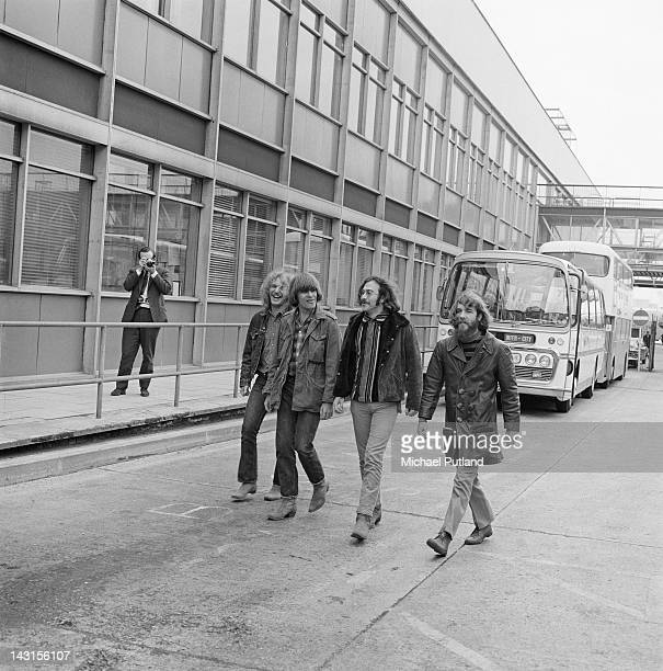 American rock group Creedence Clearwater Revival at London Airport 7th April 1970 Left to right rhythm guitarist Tom Fogerty singer and lead...
