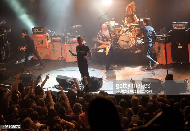 American rock group Eagles of Death Metal perform on stage on November 13 2015 at the Bataclan concert hall in Paris few moments before four men...