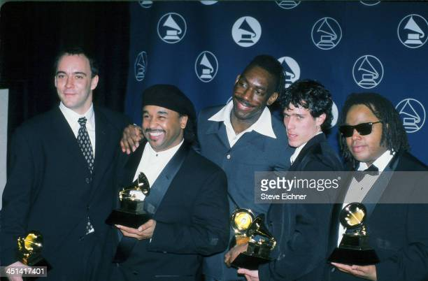American rock group the Dave Matthews Band pose with their trophies backstage at the 39th Annual Grammy Awards February 26 1997