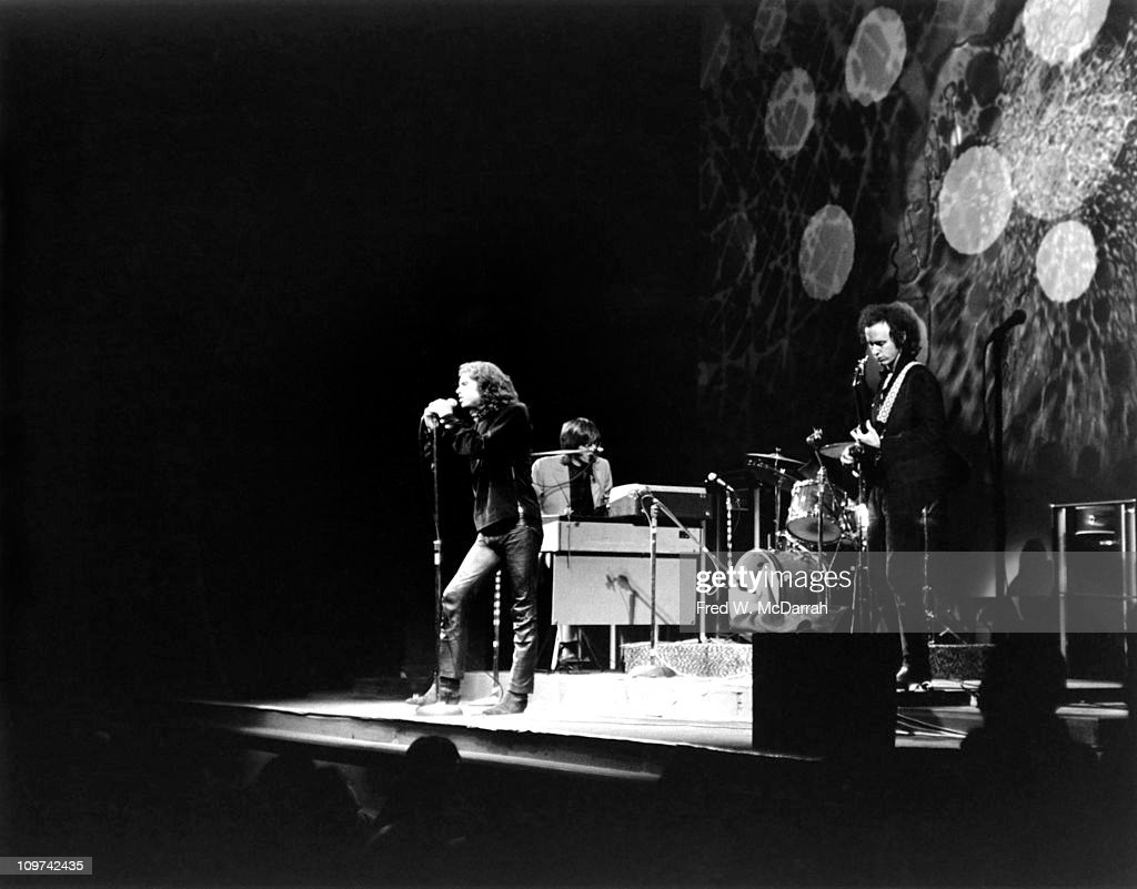 American rock group the Doors perform on stage at the Fillmore East concert venue, New York, New York, March 22, 1968. Pictured are, from left, singer <a gi-track='captionPersonalityLinkClicked' href=/galleries/search?phrase=Jim+Morrison&family=editorial&specificpeople=200754 ng-click='$event.stopPropagation()'>Jim Morrison</a> (1943 - 1971), keyboard player <a gi-track='captionPersonalityLinkClicked' href=/galleries/search?phrase=Ray+Manzarek&family=editorial&specificpeople=926931 ng-click='$event.stopPropagation()'>Ray Manzarek</a>, and guitarist <a gi-track='captionPersonalityLinkClicked' href=/galleries/search?phrase=Robby+Krieger&family=editorial&specificpeople=1846343 ng-click='$event.stopPropagation()'>Robby Krieger</a>; drummer John Densmore is hidden behind Krieger.