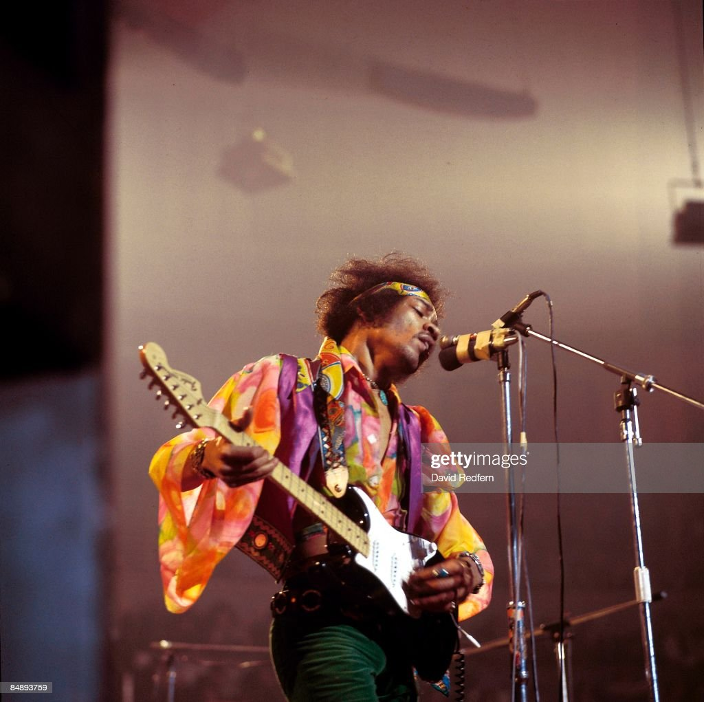 HALL Photo of Jimi HENDRIX performing live onstage playing black Fender Stratocaster