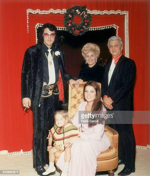 American rock legend Elvis Presley with his wife Priscilla their daughter Lisa Marie and Presley's personal doctor George Nichopoulos and his wife