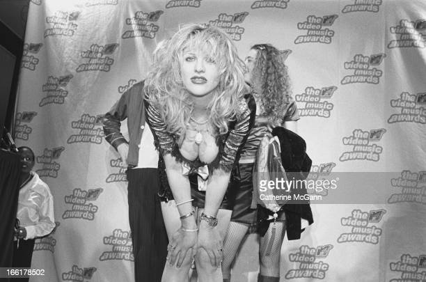 American rock musician and actress Courtney Love poses for a photo with her band Hole at the press podium backstage at the 12th annual MTV Awards on...