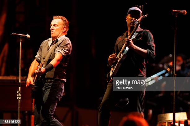 American rock musician Bruce Springsteen performs on stage with the E Street Band and special guest Tom Morello during the 'Wrecking Ball' tour at...