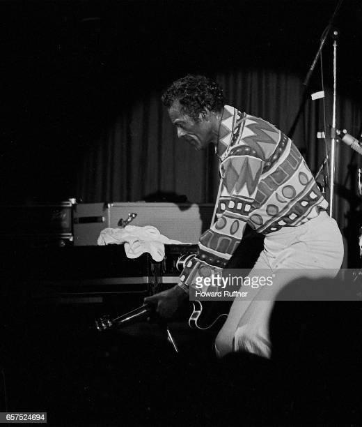 American Rock musician Chuck Berry plays guitar as he performs onstage Cleveland Ohio March 21 1986 The concert was held on the 34th anniversary of...