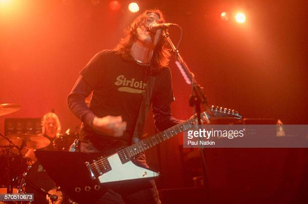 American Rock musician Dave Grohl of the band Foo Fighters plays guitar as he performs at the Riviera Theater Chicago Illinois December 15 2001...