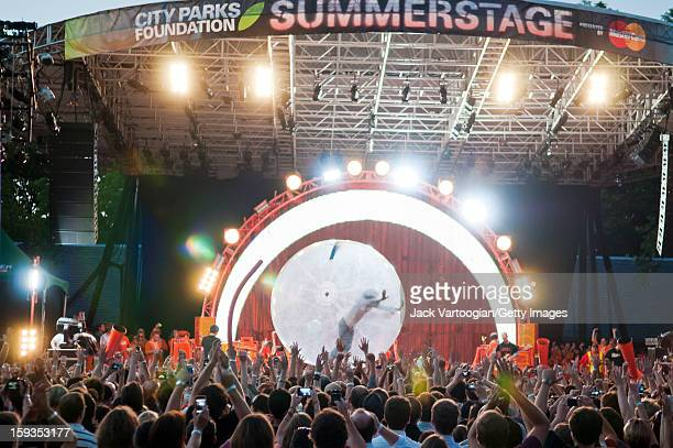 American rock musician Wayne Coyne of the band the Flaming Lips performs from inside a bubble at a Benefit on Central Park's SummerStage New York New...