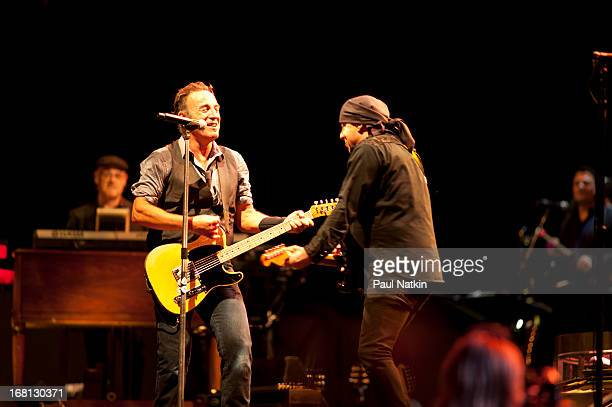 American rock musicians Bruce Springsteen and Steve Van Zandt perform on stage with the E Street Band during the 'Wrecking Ball' tour at Wrigley...