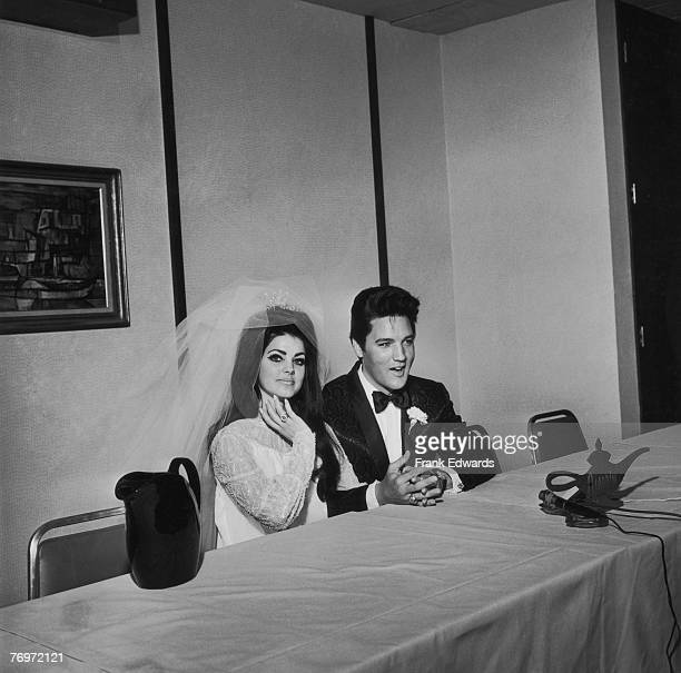 American rock n' roll singer and actor Elvis Presley with his bride Priscilla Presley on their wedding day at the Aladdin Hotel Las Vegas Nevada 1st...