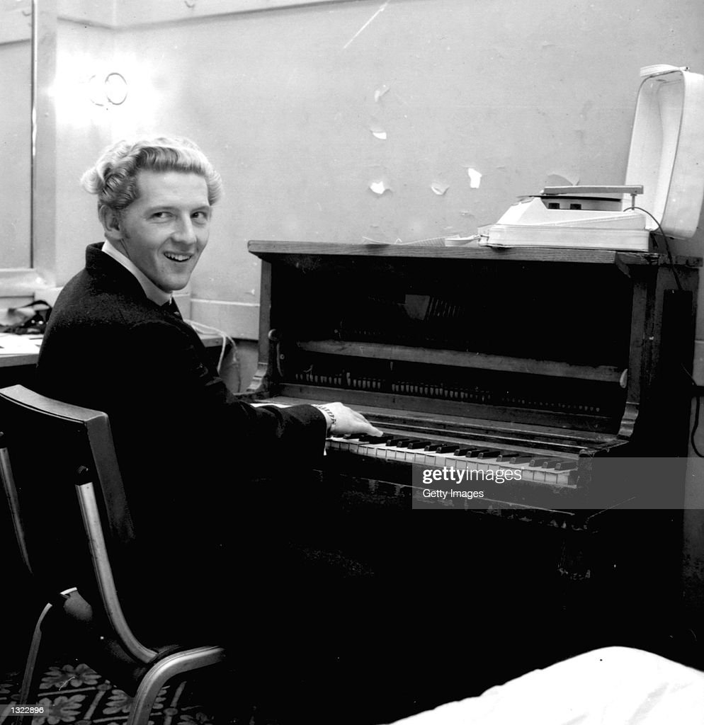 American 'rock n'' roll' singer and pianist Jerry Lee Lewis smiles over his shoulder while playing the piano in a dressing room in an undated photo. Lewis, at the age of 65, was hospitalized for reccuring pneumonia his father-in-law Bob McCarver said June 17, 2001 in Memphis, TN.