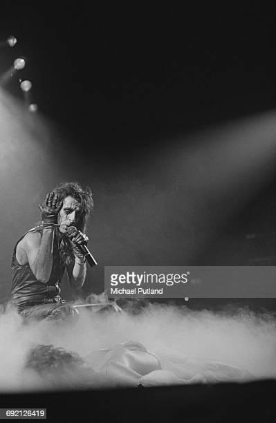 American rock singer Alice Cooper performing on stage December 1986