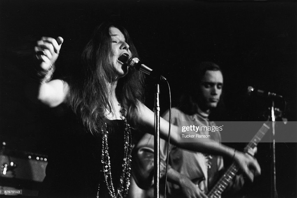 American rock singer Janis Joplin performs on stage with bassist Peter Albin of Big Brother and the Holding Company at the Generation Night Club San...
