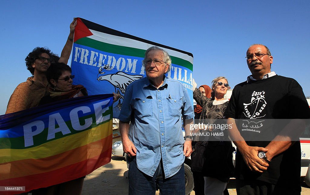 American scholar and activist Noam Chomsky (C), a leading intellectual highly critical of Israel's policies toward the Palestinians, attends a protest with Palestinian and pro-Palestinian activists, in Gaza port on October 20, 2012 to support the Estelle ship, carrying pro-Palestinian activists seeking to breach Israel's naval blockade on Gaza. Israeli troops led Finnish-flagged Estelle boat to Ashdod port in southern Israel, blocking the latest attempt to reach the enclave by sea, the military said.