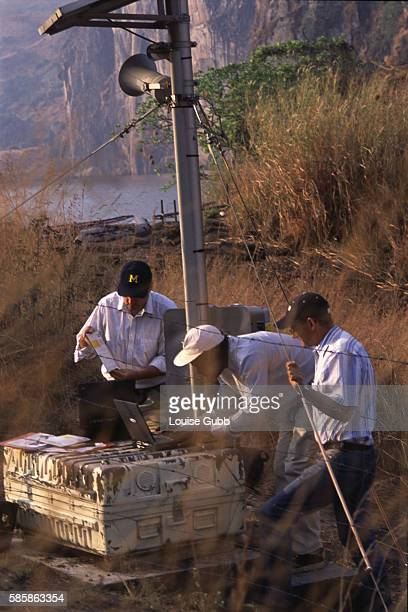 American scientists Professor George Kling and Bill Evans of the US Geological Service work with Cameroonian scientist Paul Nia to load software that...