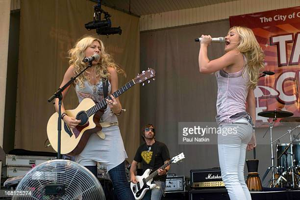 American sibling pop musicians and actresses Alyson and Amanda Michalka who perform as Aly and AJ play on the Petrillo Band Shell in Grant Park...