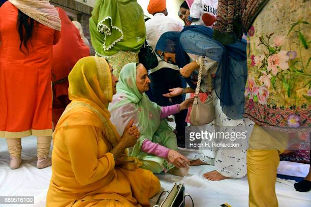 American Sikhs take part in the Vaisakhi ceremony inside East High School before the second annual American Sikh day parade on May 28 2017 in Denver...