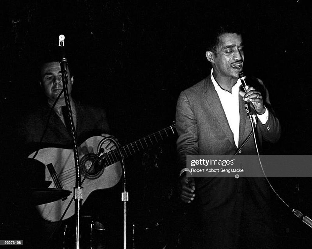 American singer, actor, and entertainer Sammy Davis Jr. (1925 - 1990) performs at the 'Stars for Freedom' rally, Montgomery, Alabama, March 24, 1965. The rally occured on the last night of the historic Selma to Montogmery march in support of voter rights; the following day, 25,000 marchers, led by American Civil Rights leader Dr. Martin Luther King Jr., arrived at the State Capitol Building and listened to King deliver his 'How Long, Not Long' speech.