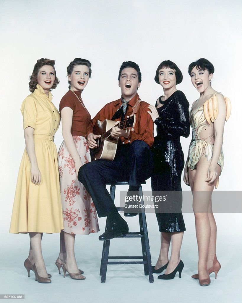 American singer, actor Elvis Presley surrounded by actresses Jan Shepard, Dolores Hart, Carolyn Jones and French actress Liliane Montevecchi on the set of King Creole directed by Hungarian-American Michael Curtiz.