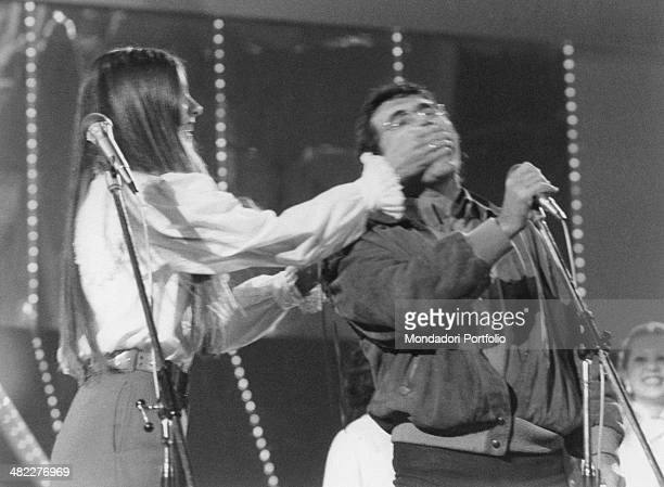 American singer actress and painter Romina Power and her husband and Italian singersongwriter and actor Al Bano taking part in the 32nd Sanremo Music...