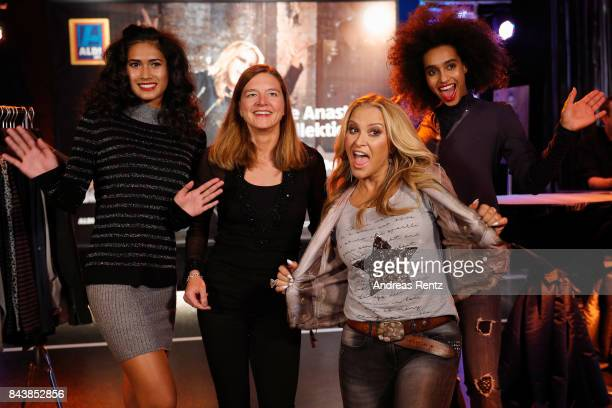 American singer Anastacia and Kim Aline Suckow pose with models prior to the ALDI SUED x Anastacia collection launch 'Music loves Fashion' at EWerk...