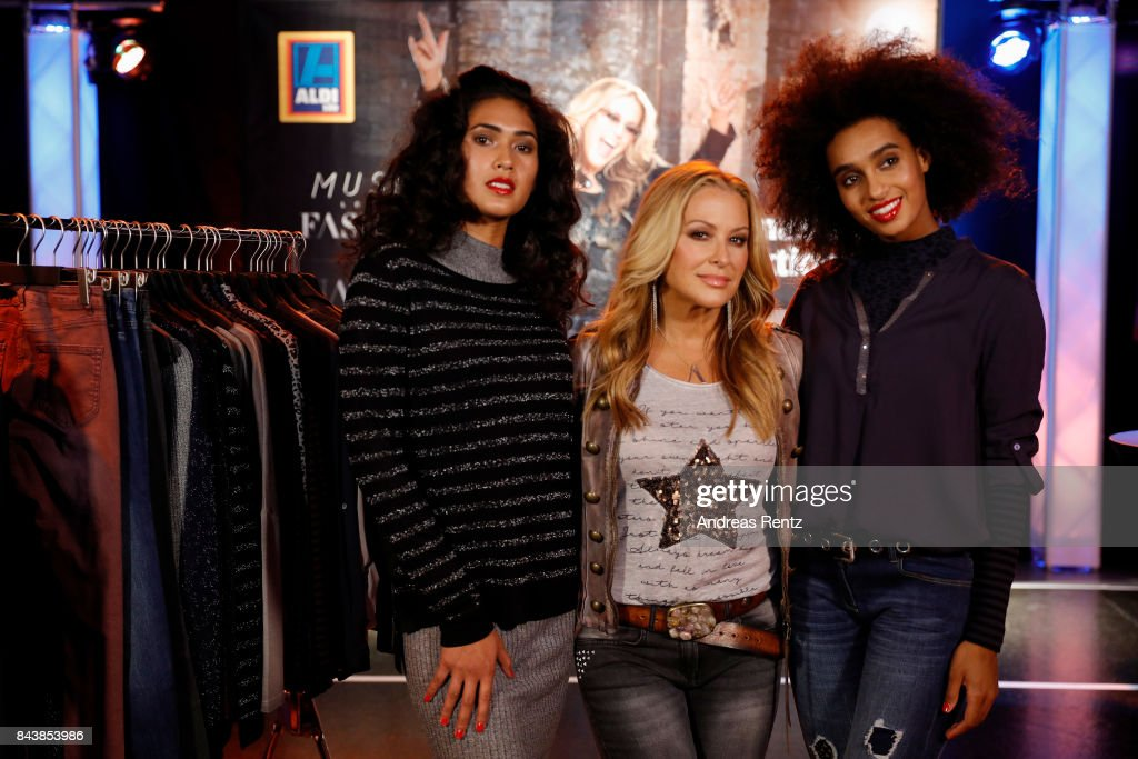 American singer Anastacia (C) poses with models prior to the ALDI SUED x Anastacia collection launch 'Music loves Fashion' at E-Werk on September 7, 2017 in Cologne, Germany.