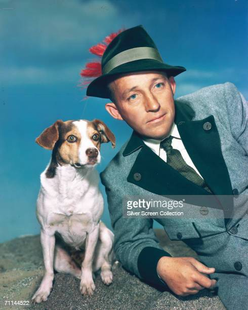 American singer and actor Bing Crosby with a small dog circa 1950