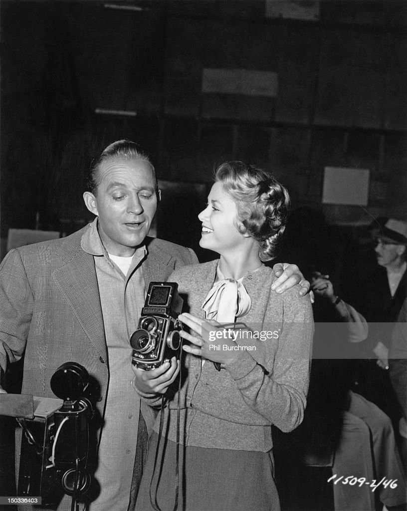 American singer and actor <a gi-track='captionPersonalityLinkClicked' href=/galleries/search?phrase=Bing+Crosby&family=editorial&specificpeople=90412 ng-click='$event.stopPropagation()'>Bing Crosby</a> (1903 - 1977) with American actress <a gi-track='captionPersonalityLinkClicked' href=/galleries/search?phrase=Grace+Kelly+-+Actress&family=editorial&specificpeople=70044 ng-click='$event.stopPropagation()'>Grace Kelly</a> (1929 - 1982), circa 1955. Kelly is holding a Rolleiflex twin-lens reflex camera.