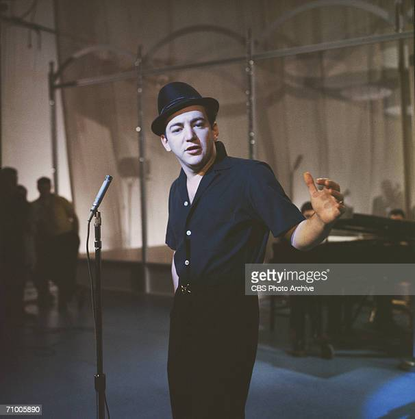American singer and actor Bobby Darin performs on stage during rehearsals for an appearance on the television variety program 'The Ed Sullivan Show'...