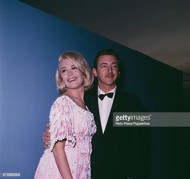 American singer and actor Bobby Darin pictured with his wife actress Sandra Dee at the 37th Academy Awards or Oscars at the Santa Monica Civic...