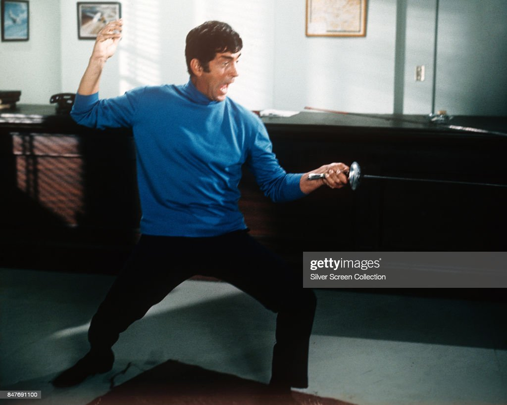 American singer and actor Dean Martin (1917 - 1995) in fencing position, circa 1968.