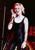 1979 American singer and actor Debbie Harry performs in a black spandex unitard onstage with her group Blondie at Hammersmith Odeon London England