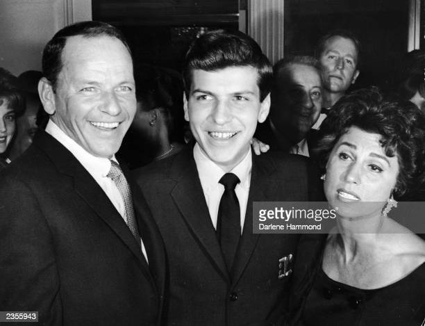 American singer and actor Frank Sinatra poses with his son Frank Sinatra Jr and his first wife Nancy Barbato at the Cocoanut Grove California March...