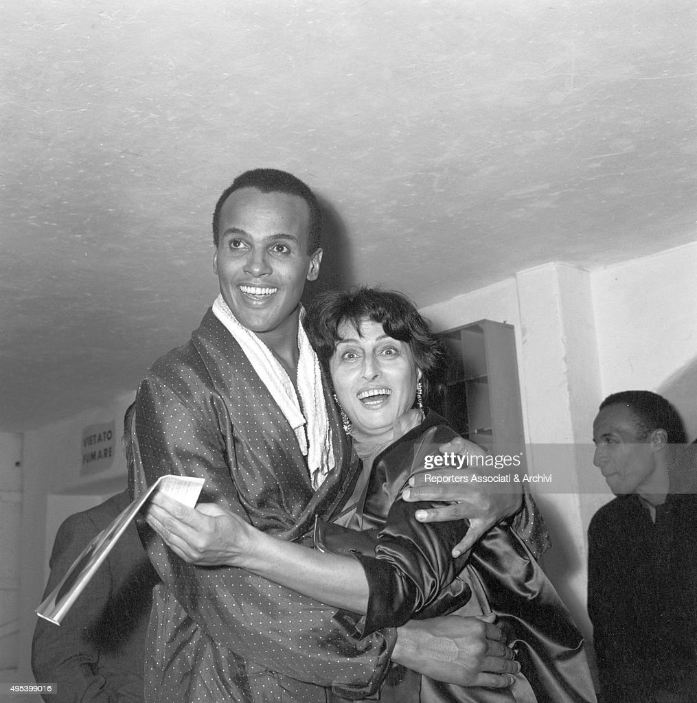 American singer and actor Harry Belafonte hugging Italian actress Anna Magnani after a concert at Sistina Theatre Rome 2nd October 1958