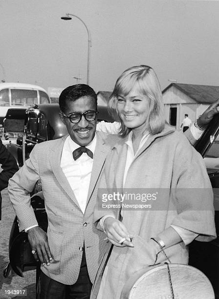American singer and actor Sammy Davis Jr meets his girlfriend Swedish actor May Britt at London Airport England June 1960 The two were married later...