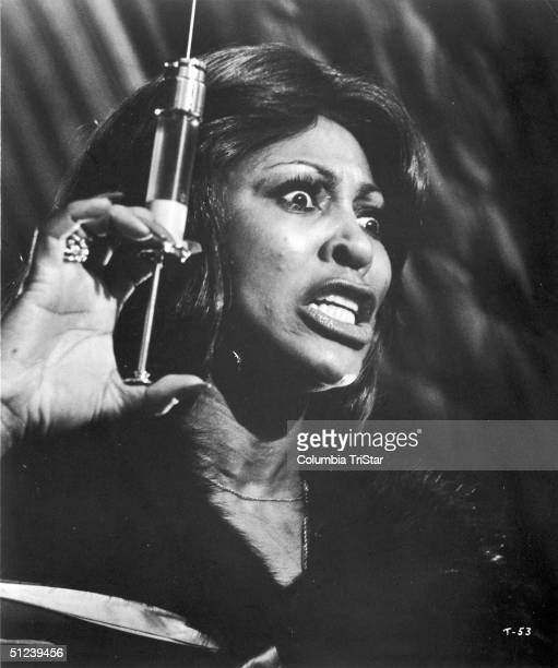 1975 American singer and actor Tina Turner holds a large syringe in a still from the film 'Tommy' directed by Ken Russell
