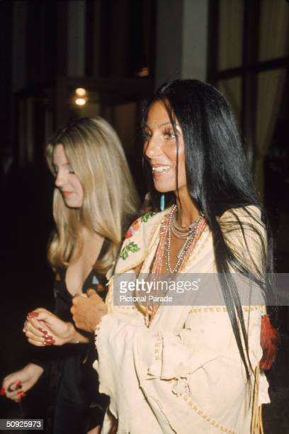 American singer and actress Cher stands in a Native American poncho alongside her halfsister the actress Georganne LaPiere at the premiere of 'Last...