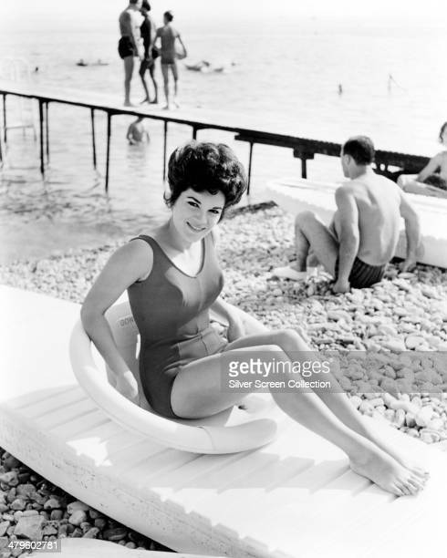 American singer and actress Connie Francis sitting on a kayak in a onepiece swimsuit circa 1963