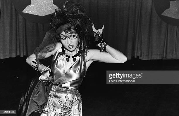 American singer and actress Cyndi Lauper gestures onstage at the annual Grammy Awards ceremonies where she appeared as a presenter February 1984