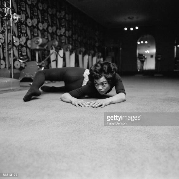 American singer and actress Eartha Kitt exercising at the Town and Country Health Salon in Knightsbridge London 1st April 1965